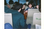 Greg Graves playing guitar on bus to meet the ferry, AYA trip to Switzerland, Apr. 1972